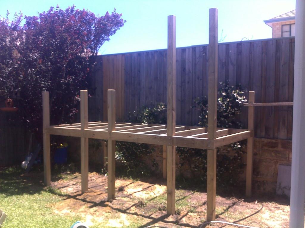 Childrens garden cubby playhouse top notch pergolas for Garden decking framework