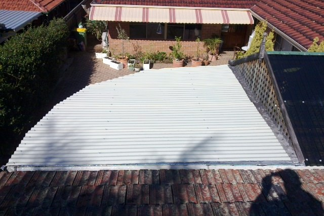 Polycarbonate roof repaired after being smashed to pieces by large hail by Perth patio builder Top Notch Pergolas & Gazebos