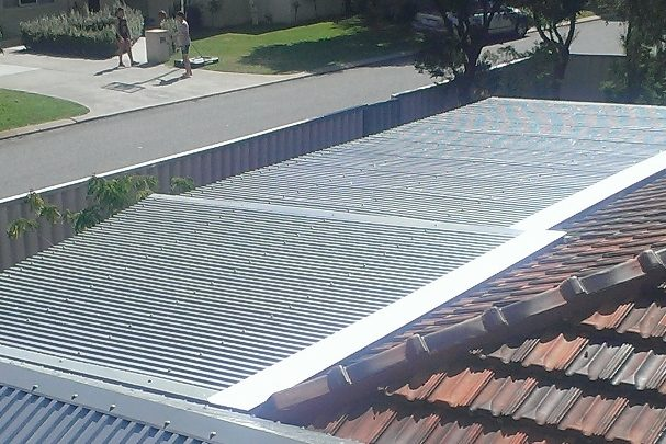 Patio builders roofing after